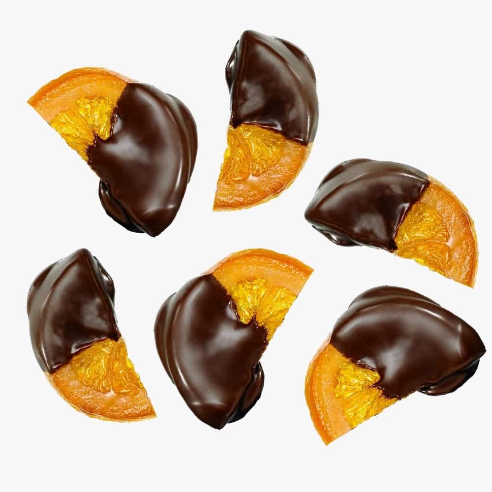 Gekonfijte sinaasappelschijven gedipt in pure chocolade